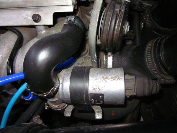 IAC valve under the throttle cover