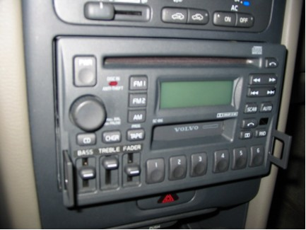 Press In The Tabs On Each Side Of Radio With A Small Instrument Being Careful Not To Scratch Will Click And Then Partially Slide Out