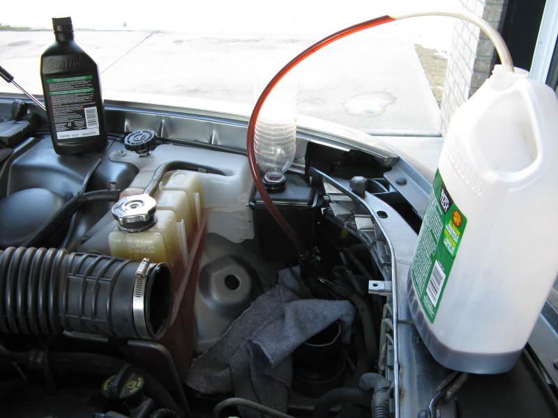 File Alfetta front suspension also Car Power Steering Leak likewise How To Flush Volvo Power Steering Pump moreover 411459 Diy 2003 2008 Corolla Matrix Pontiac Vibe Power Steering Fluid Exchange W Pics also Rav4 06. on power steering reservoir location 2012 camry