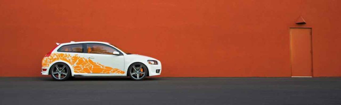 C30 in front of orange wall