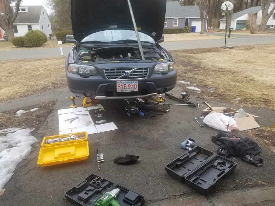 Car's off the ground, front wheels off, tools everywhere :-)