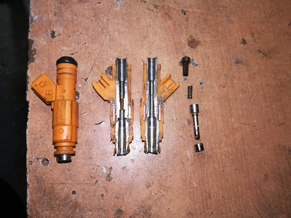 Volvo yellow injector cutaway photo showing the insides